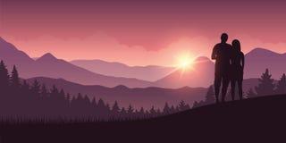 Le coppie godono della vista del paesaggio della montagna all'alba illustrazione vettoriale
