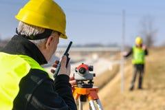 Le cordon de mesure de Geodesist parlent l'émetteur Photographie stock