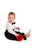 Le costume de monsieur de bébé garçon et le papillon de lien avec se sont levés Photographie stock