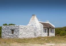Le cottage du pêcheur traditionnel chez le Cap des Aiguilles Afrique du Sud Photographie stock libre de droits