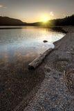 Le coucher de soleil au-dessus du lac pend Oreille Image libre de droits