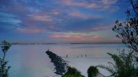 Le coucher du soleil au-dessus des Brighton-Le-sables ?chouent, Sydney, images stock