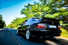 Le coucher du soleil sportcar GT de supersprint de bête de voiture de BMW E36 M3 emballent le coupé 2doors Photographie stock libre de droits