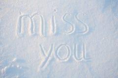 Le coup manqué de mot que vous dessinez sur la neige Photographie stock