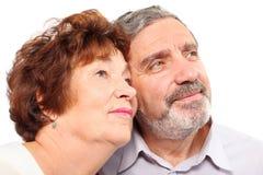 Le couple fait face à la verticale de visages de couples de portsenior Photos libres de droits