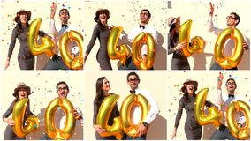 Le couple gai célèbre un anniversaire de quarante ans avec de grands ballons d'or Photographie stock libre de droits