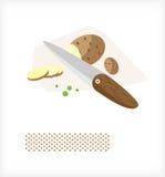 Le couteau coupe les pommes de terre A Images libres de droits