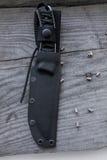 Le couteau de chasse dans une couverture Images stock