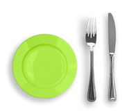 Le couteau, la plaque verte et la fourchette ont isolé la première vue Photo stock