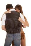 Le cowboy et la femme indienne regardent au-dessus de son épaule Images stock