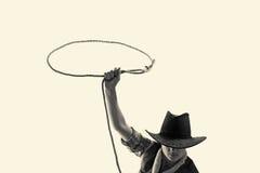 Le cowboy jette un lasso Images stock