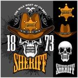 Le cowboy Skull dans le chapeau et les shérifs se tiennent le premier rôle Photos stock