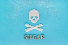 Le crâne désosse le sucre, dispersion du sucre granulé, le SUCRE des textes, b Photos libres de droits