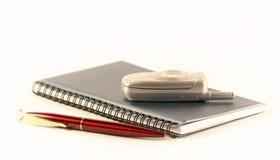 Le crayon lecteur et le téléphone portable Image stock