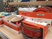 Le Creuset products displayed in a shop