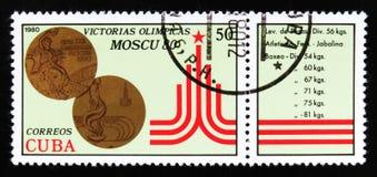 Le Cuba montre des médailles de bronze, victoire de série d'athlètes cubains aux Jeux Olympiques 1980 d'été à Moscou, vers 1980 Photographie stock libre de droits