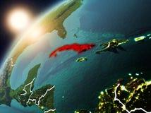 Le Cuba sur terre de planète dans le coucher du soleil Images stock