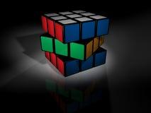 Le cube des rubik non résolus sur le noir Photographie stock libre de droits