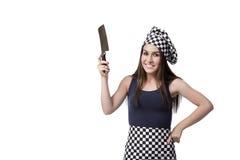 Le cuisinier de jeune femme d'isolement sur le fond blanc Photo libre de droits