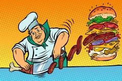 Le cuisinier prépare l'hamburger Restaurant d'aliments de préparation rapide Photo stock