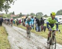 Le cycliste Daniele Bennati sur une route pavée en cailloutis - Tour de France 2 Images stock