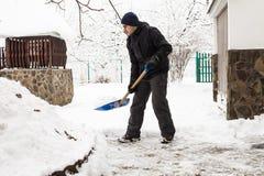 Le déblaiement de neige photo stock