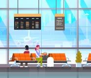 Le décollage de attente de personnes dans l'aéroport Hall Or Departure Lounge Passangers terminal signent l'intérieur Photos libres de droits