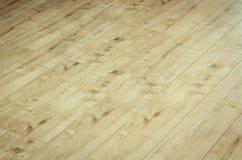 Le détail d'un beau brun en bois a stratifié le plancher Photos libres de droits