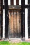 Le détail extérieur de maison de Tudor a établi en 1590 le détail du plan rapproché de hall de Blakesley de porte image libre de droits