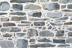 Le détail historique de mur en pierre avec le mortier augmenté joint Photos libres de droits