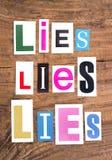 Le ` d'expression se trouve, les mensonges, ` de mensonges sur le fond en bois Images libres de droits