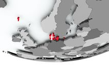 Le Danemark avec le drapeau sur le globe Images stock