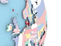 Le Danemark avec le drapeau sur le globe Photos stock
