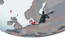 Le Danemark avec le drapeau sur le globe Photo libre de droits