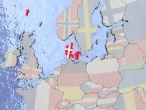 Le Danemark avec le drapeau sur le globe Images libres de droits