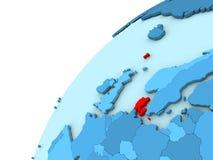 Le Danemark en rouge sur le globe bleu Photographie stock