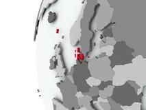 Le Danemark sur le globe avec le drapeau Photos libres de droits