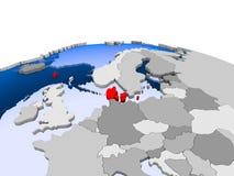Le Danemark sur le globe politique Images libres de droits