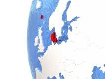 Le Danemark sur le globe Image stock