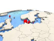 Le Danemark sur le globe avec les mers aqueuses Photographie stock libre de droits