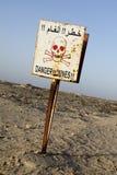 Le danger extrait le signe Photographie stock