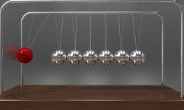 Le ` de équilibrage s de Newton de boule bercent le pendule avec la tache floue de mouvement au-dessus du fond foncé Photo libre de droits