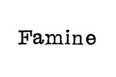 Le ` de famine de ` de mot d'une machine à écrire sur le blanc Image stock