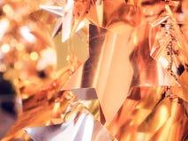 Le De a focalisé l'étoile d'or et le fond blanc de lumières de scintillement de bokeh, foyer mou Image stock