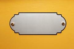 Le de plaque métallique sur le mur Image libre de droits