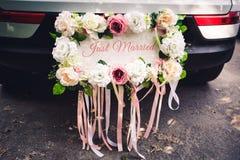 Le ` de plaque de mariage A JUSTE MARIÉ le ` pour la voiture Photographie stock libre de droits