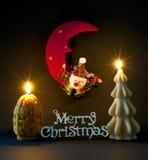 Le decorazioni di natale si sono illuminate dalle candele Fotografia Stock