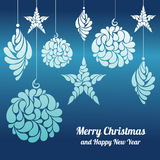 Le decorazioni di Natale star, un diamante della palla su un fondo blu Fotografia Stock Libera da Diritti
