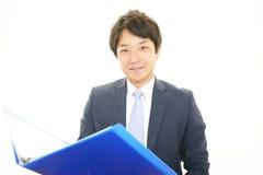 Le den asiatiska affärsmannen Royaltyfria Bilder