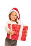 Le den lyckliga flickan med isolerad stor gåva royaltyfri bild